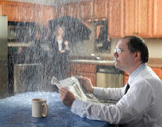 People in need of roof repair in Marina del Rey CA. Leaky roof causing it to rain on people in their kitchen. Humorous.