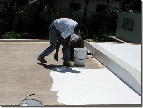 Roofer applying roof coating in Reseda, CA
